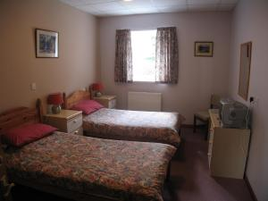 The Bedrooms at Fairburn Lodge