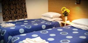 The Bedrooms at Arriva Hotel