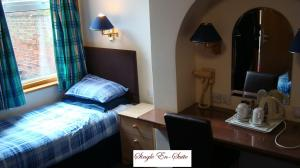 The Bedrooms at Donnington House Hotel