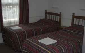 The Bedrooms at Arch Guest House