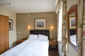 The Bedrooms at The Woolpack Inn