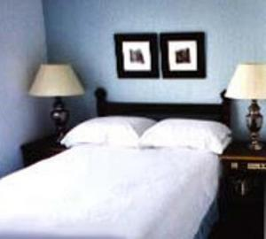 The Bedrooms at Dukes Of Windsor Street Hotel