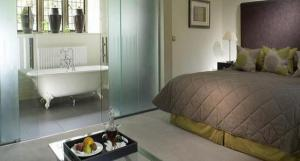The Bedrooms at Lower Slaughter Manor - A Relais and Chateaux Hotel