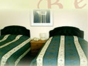 The Bedrooms at Belle Vue House Hotel