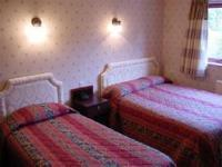 The Bedrooms at Huntingdon House Hotel