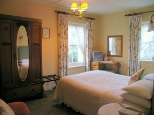 The Bedrooms at The Woodstock House Hotel - Guest House
