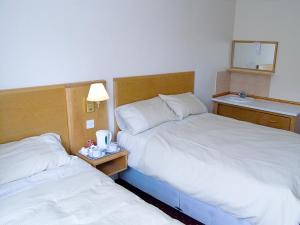 The Bedrooms at Junction 10 Budget Travel Accommodation
