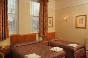 The Bedrooms at Channins Hounslow Hotel