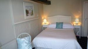 The Bedrooms at Orles Barn